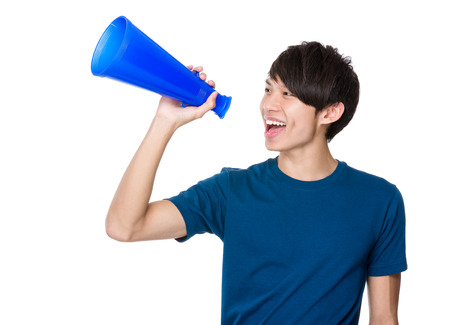 yell: Man yell with megaphone Stock Photo