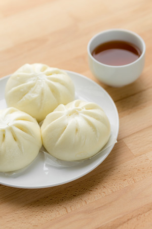 Chinese steamed buns on wood background photo