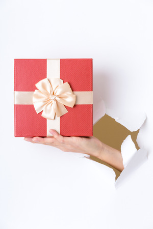 though: Paper though the gift box Stock Photo