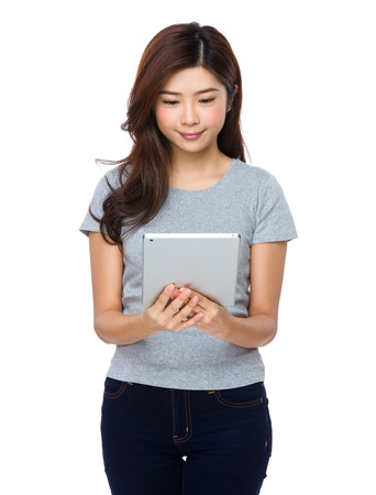 Asian woman student smile face and happy with holding a computer tablet photo
