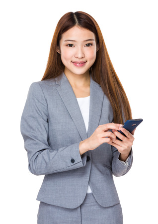 phonecall: Young businesswoman with smartphone Stock Photo