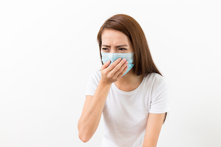 masked: Asian woman sneeze with mask