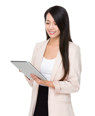 china people: Asian businesswoman use of digital tablet