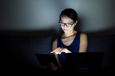 Asian woman use notebook computer at home photo