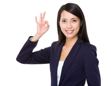 Asian businesswoman with ok gesture photo