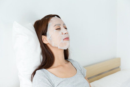 bed sheets: Young woman do masking