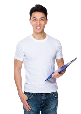 causal clothing: Asian young man hold a clipboard