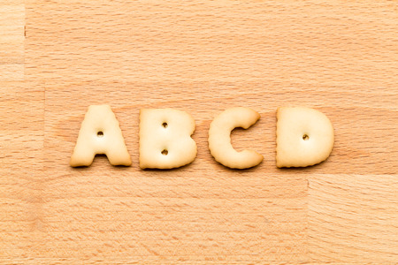 noun: Letter ABCD cookies over the wooden background