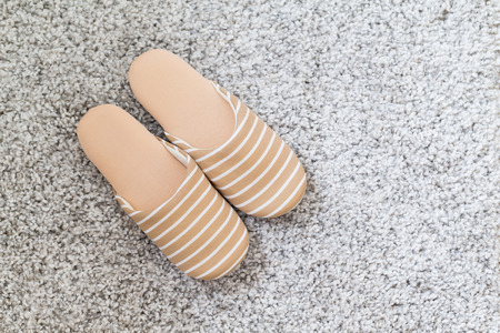 footware: Pair of slippers on carpet Stock Photo