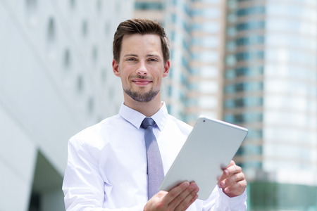 american banker: Young businessman use of the digital tablet