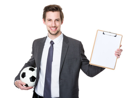 american banker: Caucasian scooer manager holding with football and showing with clipboard