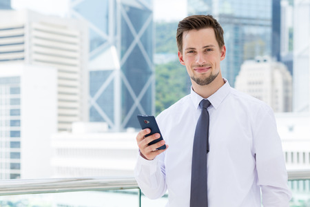 american banker: Young businessman use of the smartphone at outdoor Stock Photo