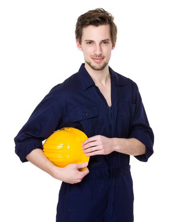 yellow hard hat: Caucasian engineer hold with yellow hard hat