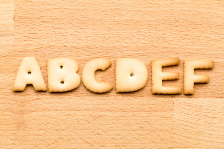 noun: Letter ABCDEF cookie over the wooden background