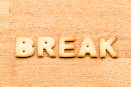 tea breaks: Word break cookie over the wooden background Stock Photo