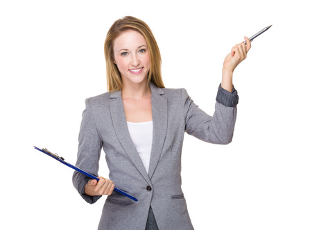 Businesswoman with clipboard and pen up
