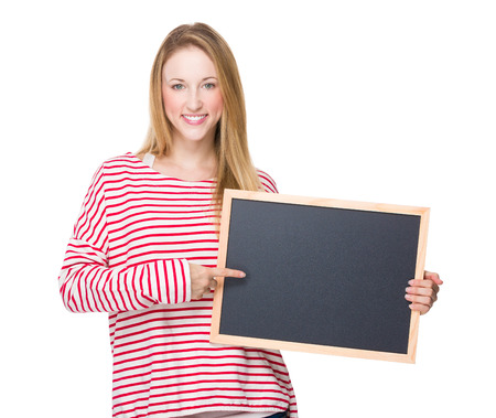 Woman point to chalkboard Stock Photo
