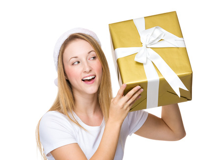 guess: Xmas girl guess the thing in big gift box Stock Photo