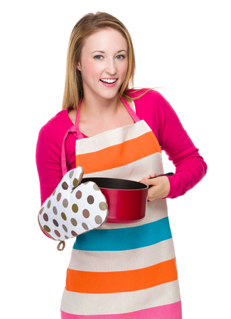 housewife gloves: Housewife cooking with saucepan oven gloves