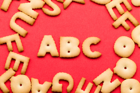 english food: ABC cookie over the red background