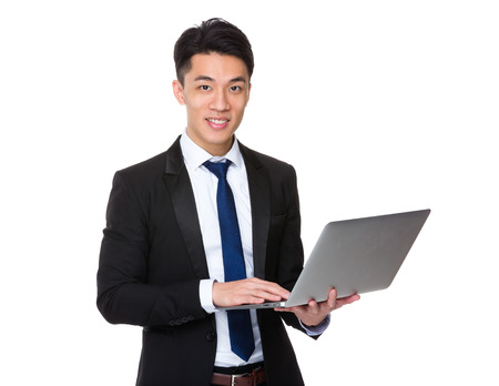 joyful businessman: Asian businessman use of laptop computer Stock Photo