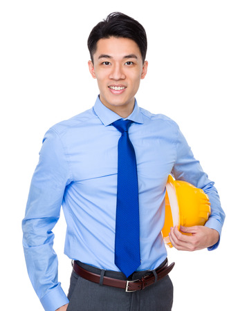 yellow helmet: Engineer hold with yellow helmet Stock Photo
