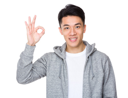 Young man with ok sign gesture 版權商用圖片