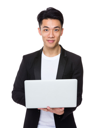 casual wear: Asian businessman hold with laptop computer