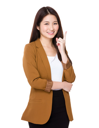one finger: Young businesswoman think of the idea with one finger up Stock Photo