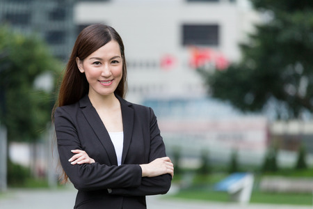 wealth: Confident Businesswoman armed crossed