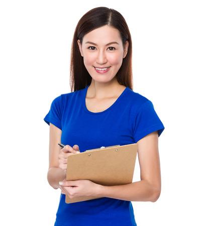 jot: Asian woman jot note on clipoard