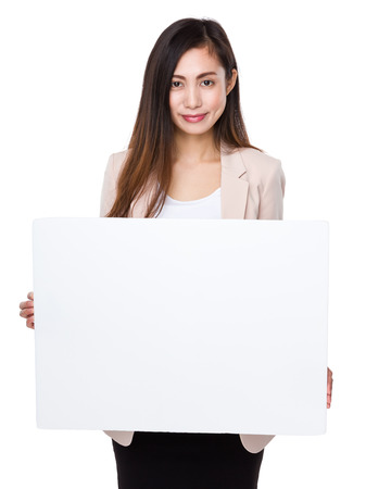 a placard: Asian businesswoman show with placard