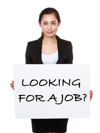 looking for job: Beautiful businesswoman showing a board showing with looking for a job phrases Stock Photo