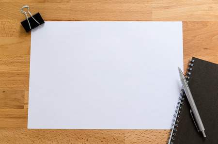 adding: Working desk with plain paper for adding some information