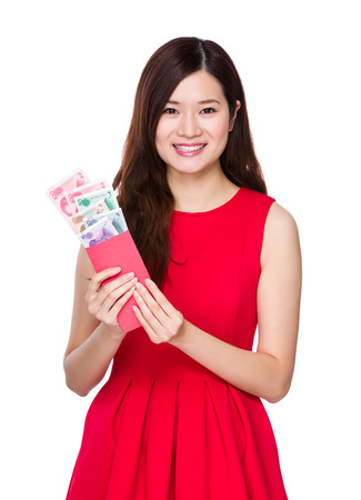 rmb: Woman hold red pocket with RMB Stock Photo