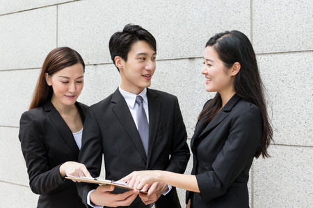 happy business team: Business team discuss about the information on file