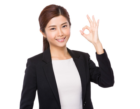 Asian Businesswoman with ok sign gesture Stock Photo