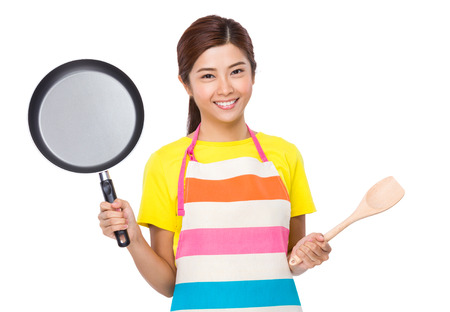 pan asian: Asian Housewife raised up with frying pan and wooden ladle