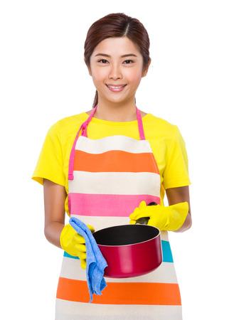 stockpot: Asian Housewife washing the saucepan Stock Photo