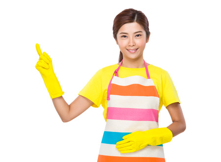 housewife gloves: Housewife with plastic gloves and finger point up