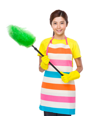 japanese cookery: Young Housewife using duster with plastic gloves Stock Photo