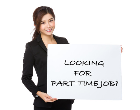 chinese lady: Beautiful business woman showing a poster showing with looking for part-time job phrases Stock Photo