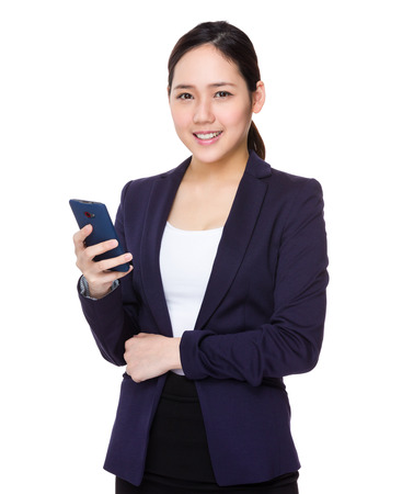 buisness: Buisness woman use of cellphone Stock Photo