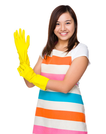 plastic glove: Young housewife wear with plastic glove Stock Photo