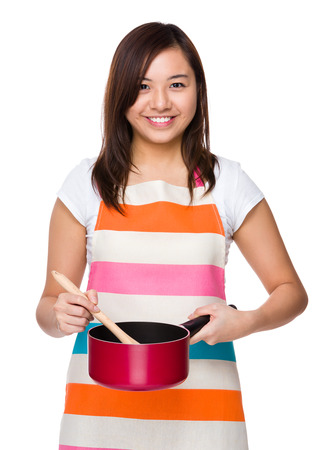 japanese cookery: Asian housewife use of the saucepan Stock Photo