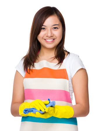 plastic glove: Young housewife with plastic glove and rag