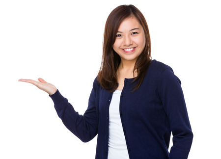 Asian woman showing the blank area for selling something 版權商用圖片