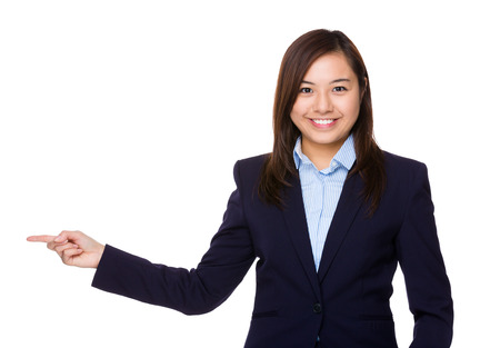 aside: Businesswoman with finger point aside Stock Photo
