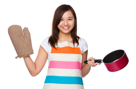 saucepan: Housewife holding with saucepan and oven glove Stock Photo