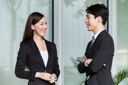 Businesswoman and businessman discuss together Stock Photo